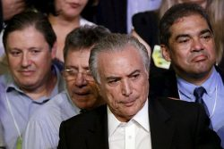 Brazil's Vice President Michel Temer (C) looks on during the Brazilian Democratic Movement Party (PMDB) national convention in Brasilia, Brazil, March 12, 2016. REUTERS/Ueslei Marcelino