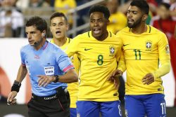 Jun 12, 2016; Foxborough, MA, USA; Brazil forward Gabriel (11) and midfielder Elias (8) and midfielder Philippe Coutinho (22) argue with referee Andres Cunha during the first half of the group play stage of the 2016 Copa America Centenario at Gillette Stadium. Mandatory Credit: Winslow Townson-USA TODAY Sports